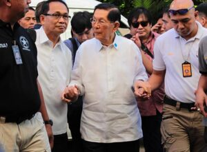 Senate Minority Floor Leader Juan Ponce Enrile (center) arrives at the Sandiganbayan in Quezon City on Friday, July 11, to attend his arraignment on graft and plunder charges in connection with the alleged P10-billion pork barrel scam. He faces one count of plunder and 15 counts of graft. (MNS photo)