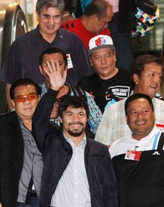 Filipino boxing icon and Sarangani Rep. Manny Pacquiao waves to his well-wishers upon his arrival at the Ninoy Aquino International Airport (NAIA) Terminal 2 from the United States at 4:30 a.m. Friday (April 18, 2014). (MNS photo)