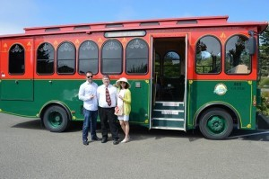 Jannelle and Lester pose by the vintage trolley, with Jeffrey Beared of the MTA, who drove and accompanied guests on their tour of Mendocino Coast, specifically designed by the couple.