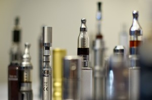"A selection of ""Nicotine Containing Products"", or ""NCP""s displayed during ""The E-Cigarette Summit."" Supporters say the gadget can help wean smokers off conventional tobacco. ©AFP PHOTO / LEON NEAL"