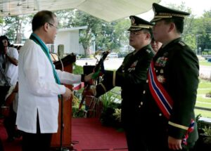 President Benigno S. Aquino III hands-over the Saber to Lt. Gen. Gregorio Catapang Jr. during the Armed Forces of the Philippines Change of Command ceremony at the AFP General Headquarters grandstand of Camp General Emilio Aguinaldo last July 18. Retiring AFP Chief Emmanuel Bautista has been replaced by Lt. General Catapang (MNS photo)