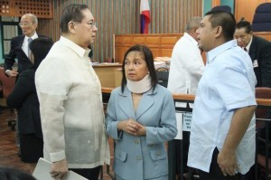 File photo of former President Gloria Arroyo (center) with husband Mike Arroyo (left).