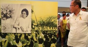 "President Benigno S. Aquino III views a photograph during the ""History and her Story"" – A Special Commemorative Photo Exhibit on the 5th Death Anniversary of former President Corazon C. Aquino at the Glorietta Activity Center in Palm Drive, Makati City on Monday (August 04, 2014). The exhibit gives its readers a rare glimpse into Mrs. Aquino's life – from her school years at the St. Scholastica's College, to her marriage to the late Senator Benigno Aquino, Jr., to the People Power revolution that changed her life, and in the process, Philippine history. It also revisits Mrs. Aquino's years as the first female President of the Philippines from 1987 to 1992. (MNS photo)"