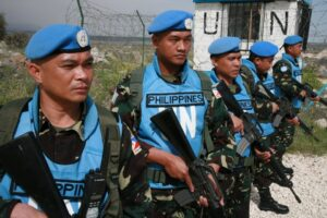 "More than 40 peacekeepers from Fiji were forced to surrender their weapons and were taken hostage in Golan Heights, but 81 Filipino blue helmets (shown above) ""held their ground"" and refused to disarm, reports from Manila said. Photo: Elmer G. Cato, DFA Consul/Golan Heights."