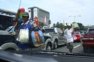 """Every time I passed through between the U.S. embassy and yacht club, Jesus Christ, a lot of vendors, I see a lot people lying around. It is unsightly,"" Senate President Franklin Drilon said. Photo: Rhony Laigo on Roxas Blvd. by Manila Hotel"