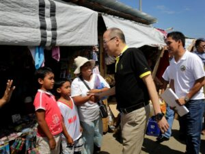 President Benigno S. Aquino III listens to the updates on the on-going rehabilitation efforts by Guiuan Municipal Mayor Christopher Sheen Gonzales at the Guiuan Public Market in Barangay 6, Poblacion, Guiuan during the visit to the province of Eastern Samar on Friday (November 07, 2014). It was in Guiuan where super typhoon Yolanda, the strongest typhoon ever recorded, made its first landfall on November 08, 2013. (MNS photo)