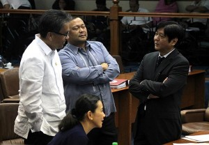 DILG Secretary Mar Roxas III (left) chats with Senators Grace Poe-Llamanzares, JV Ejercito, and Ferdinand Marcos Jr. during the Senate deliberation on the 2015 budget of the Department of Interior and Local Government on Monday, November 24.  (MNS photo)