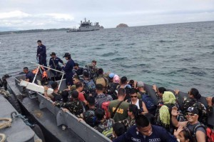 -- Filipino peacekeepers from Liberia leave Caballo Island on Tuesday after undergoing a 21-day quarantine. The soldiers, who had to be quarantined before being cleared of the dreaded Ebola virus, will undergo 2 more days of tests before reuniting with their families.(MNS photo)