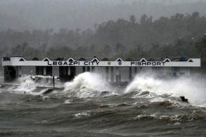 High waves brought about by strong winds pound a fish port, hours before typhoon Ruby passes near the city of Legazpi on Sunday. Ruby tore apart homes and sent waves crashing through coastal communities across central Philippines, adding to the spate of deadly disasters. (MNS photo)