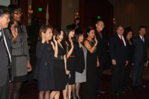 ABAOC MEETS 2015 CHALLENGES:  Newly-elected Congresswoman (behind the rostrum) inducts in office the officers and members of the board of directors of the Asian Business Association of Orange County at its 23rd Gala and Awards Night at Balboa Bay Resort in Newport Beach.