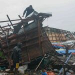 Typhoon survivors find  homes in ruins again