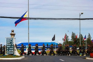 A Philippine flag flown at half-mast at Fernando Air Base Tuesday as soldiers mourn the death of 44 members of the PNP Special Action Force killed during an encounter with Moro Islamic Liberation Front (MILF) fighters. The MILF claims the clash Sunday erupted due to lack of coordination, when the elite cops tried to capture Malaysian bomb expert Marwan. (MNS photo)