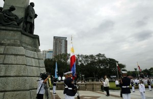 """President Benigno S. Aquino III offers a wreath during the commemoration of the 118th anniversary of the martyrdom of Dr. Jose Rizal at the Rizal National Monument in Rizal Park, Manila City on Tuesday (December 30), with the theme: """"Rizal 2014: Dunong at Pusong Pilipino."""" (MNS photo)"""