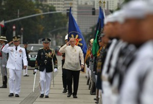 """President Benigno Simeon Aquino III, accompanied by Armed Forces of the Philippines Chief of Staff General Gregorio PioCatapang, Jr., troops the line during the full military honors accorded him upon arrival for the commemoration of the 118th anniversary of the martyrdom of Dr. Jose Rizal at the Rizal National Monument in Rizal Park, Manila City on Tuesday (December 30), with the theme: """"Rizal 2014: Dunong at Pusong Pilipino."""" (MNS photo)"""