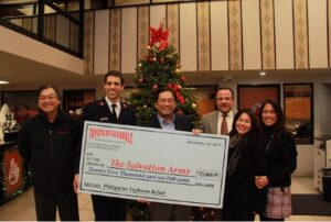 Toyota of Glendale General Manager and his Filipino Department, accompanied by Philippine Consul General Leo Herrera-Lim present a $25,000 donation check to The Salvation Army Executive Director Lt. Joshua Sneed.  Photo shows (from left)  Edwin Yu, The Salvation Army Executive Director Lt. Joshua Sneed, Philippine Consul General Leo Herrera-Lim, Toyota of Glendale General Manager Patrick Kane, Kay Cajulis, Liza Avisado