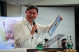 "Manila Archbishop Luis Antonio Cardinal Tagle beams with pride at the launching on Thursday of ""I am here to be with you,"" the official book on the visit of Pope Francis to the Philippines. The book contains photographs on the visit and a story written by Cardinal Tagle. (MNS photo)"
