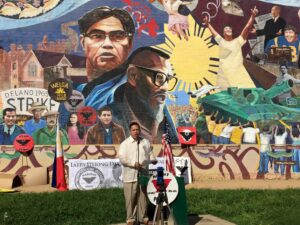 Mark Pulido, the first Fil-Am to become mayor of Cerritos, pays tribute to Fil-Am labor leader Larry Itliong at the first Larry Itliong Day in Historic Filipinotown in Los Angeles. Photo by Joy Marivic S. Macainan