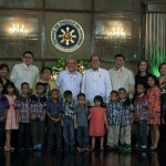 Aquino signs law protecting children during disasters, emergency situations